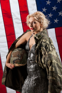 Young Attractive Woman In Military Clothing
