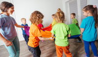Dynamic and team building games for kids with colorful canopy