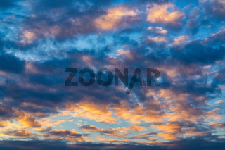Amazing clouds in blue sky, illuminated by rays of sun at sunset to change weather. Colorful abstract meteorology background