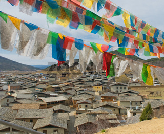 tibetan prayer flags over shangri-la, china