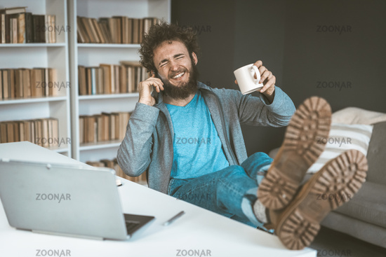 Happy freelancer works at home in quarantine. Remote work concept. High quality photo