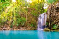Beautiful waterfall in wild rainforest in Erawan National park, Thailand