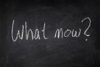 what now handwritten question on chalkboard - uncertainty, angst