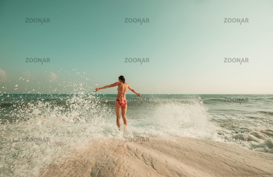 Girl in the wave