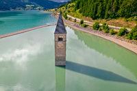 Submerged bell Tower of Curon Venosta aor Graun im Vinschgau on Lake Reschen aerial view