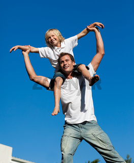 Young father with his son on his back outdoor