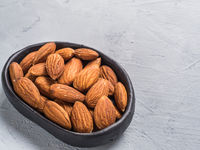 almond in black plate