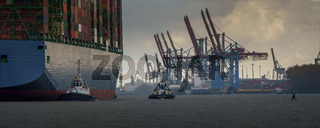 Large container ship arrives in the port of hamburg