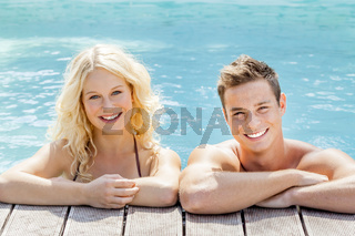 young couple at the pool