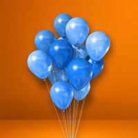 Blue balloons bunch on orange wall background