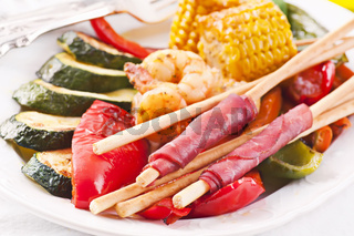 Tapas with grissini and grilled vegetables