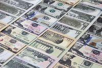 San Jose, California, USA. March 21, 2021. Close up of Several USA Dollar banknotes bills.