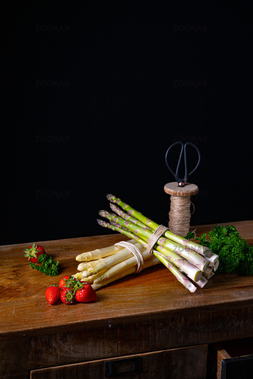 Green and white asparagus on the table