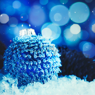 Christmas background with bauble and beauty bokeh