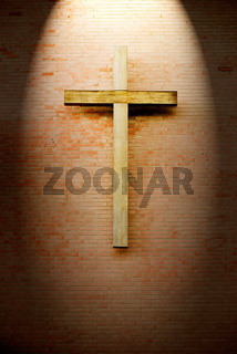 Wooden crucifix on the brick wall