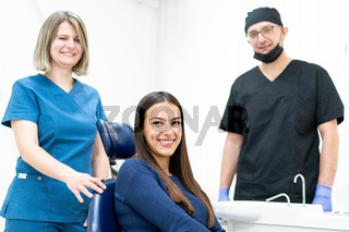 Two doctors with patient indoors, high quality photo