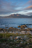 Caldebarcos panorama view of landscape with mountains at sunset with atlantic ocean in Galicia, Spain
