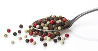 Pepper mix in spoon isolated on white background
