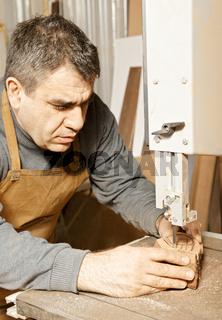 Craftsman sawing billet