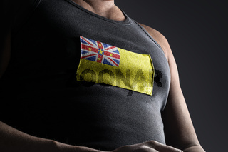 The national flag of Niue on the athlete's chest