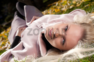 Portrait of young beautiful woman in the autumn park