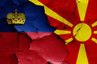 flags of Liechtenstein and North Macedonia painted on cracked wall