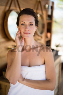 Portrait of beautiful woman in cottage