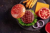 Beef burger ingredients, top shot. Hamburger steak, sesame bun, tomato etc