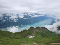 Lake Brienz on a rainy summer day. View from Mount Brienzer Rothorn.