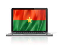 Burkina Faso flag on laptop screen isolated on white. 3D illustration