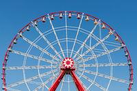 Ferris wheel on blue sky background.