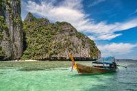Tropical islands view with long tail boat ocean blue sea water at Pileh Lagoon of Phi Phi Islands, Krabi Thailand nature landscape