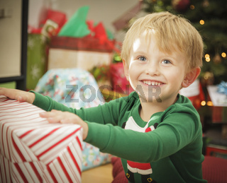 Young Boy Enjoying Christmas Morning Near The Tree