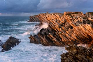 Cliffs beatiful rock details in Baleal Island with atlantic ocean crashing waves in Peniche, Portugal