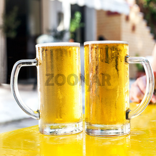 Two glasses full of fresh beer