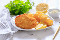 Homemade chicken escalope with baked potatoes