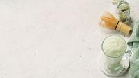 Green foam texture of matcha latte, close up