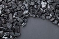 Natural Black Coals Over Black Background