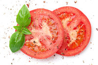 Sliced Red Tomatoes Sprinkled With Ground Pepper
