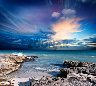 Waves breaking againt rocky coast