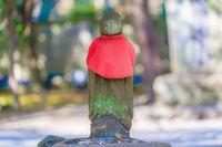 Jizo wearing a red vest