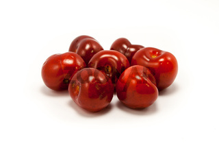 A handful of juicy ruby red cherries