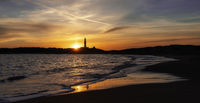sunset on the Playa de Maria Sucia Beach with the Cape Trafalgar Lighthouse in the background