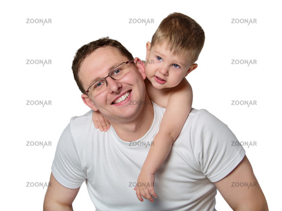 Portrait of a caring young father giving his son piggyback ride against white background