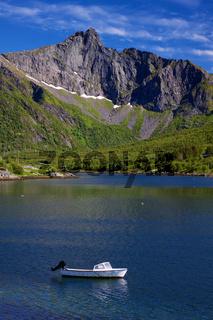 Motor boat in fjord