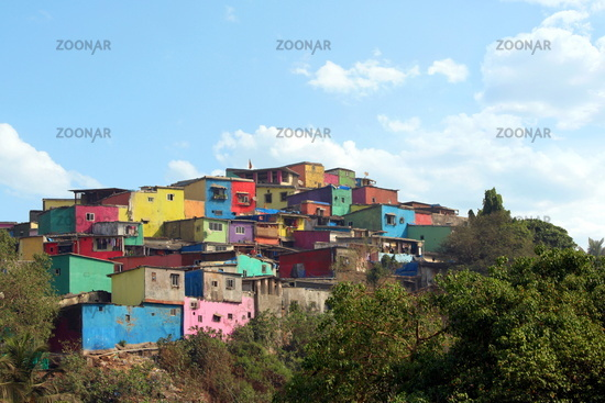 Asalpha hilltop with a line of colorful slums, Ghatkopar, Mumbai, Maharashtra. Deepya Reddy, Chal Rang De online campaign this slum.