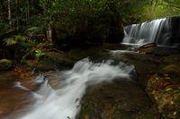 Cascading waterfall through Australian bush land