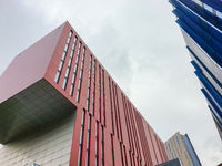 Contrasting colors and shapes on building facades against the sky in Manchester, UK