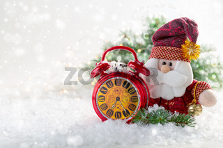 Santa Claus with a bell and a red alarm clock.