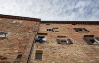 Historical architecture buildings, Montepulciano, city Tuscany, Italy against blue sky